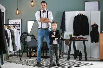 Stylish father and son, indoors