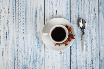 white coffe cup on light wooden background