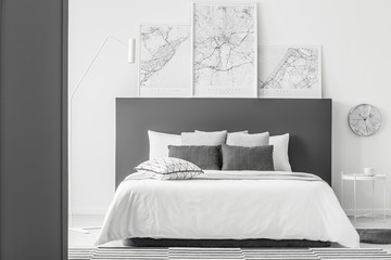Maps in simple bedroom interior