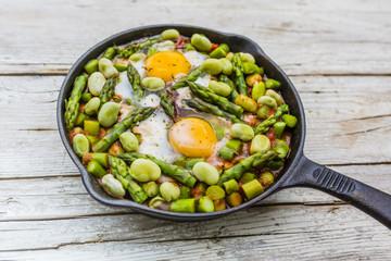 Fried shakshouka with seasonal vegetables asparagus and broad bean.