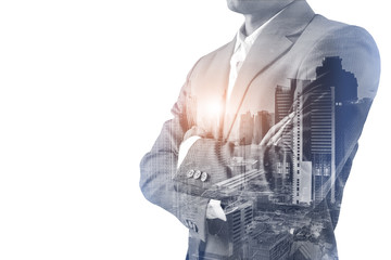 Double exposure of a Businessman wearing suit and a modern city  building of Asia Business financial district and commercial in bangkok thailand