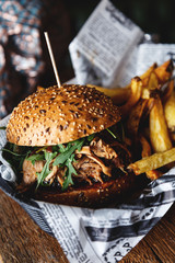Close-up of burger with french fries in a basket