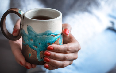 Girl holding a beautiful Cup, close-up. The concept of rest