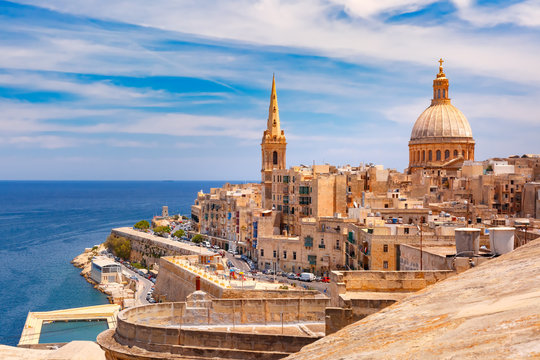 View from above of roofs and church of Our Lady of Mount Carmel and St. Paul's Anglican Pro-Cathedral, Valletta, Capital city of Malta