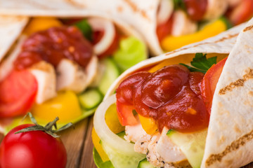 Tortilla wraps with grilled chicken and fresh vegetables