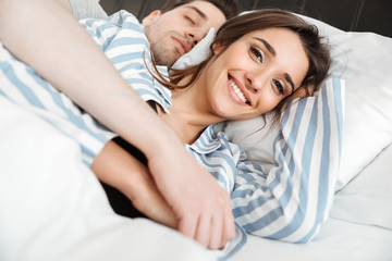 Portrait of an attractive young couple lying together