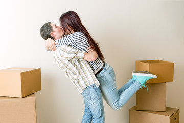 Photo of hugging men and women among cardboard boxes
