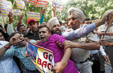 Activists from Swadeshi Jagran Manch, a wing of Hindu nationalist organisation RSS scuffle with police during a protest against U.S. retailer Walmart's majority stake buy in Indian e-commerce firm Flipkart, in New Delhi