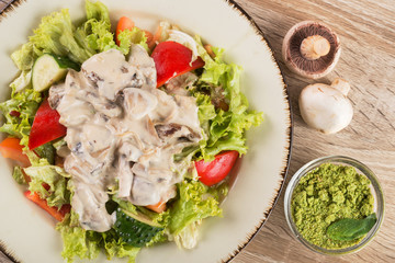 Fresh salad with mushrooms and vegetables