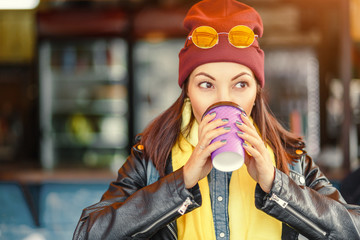 Hipster stylish woman drink takeaway hot coffee at outdoor cafe