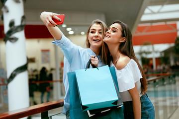 Shopping. Smiling Women Taking Photos In Shopping Centre