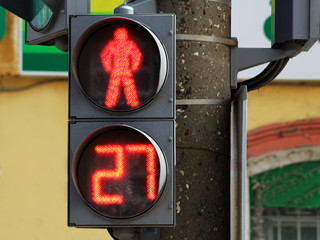 The traffic light for pedestrians, a red signal