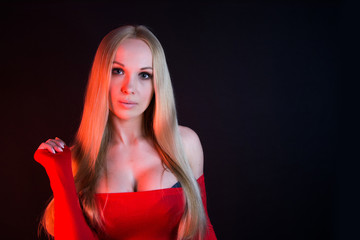 Beautiful woman with big breasts in red dress. Female sexy breast / Beautiful slim body of woman in studio / hot sexy blonde girl