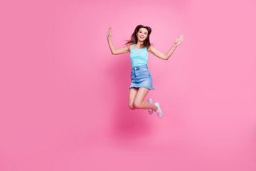 Full-size full-length portrait of beautiful attractive excited adorable lovely girl wearing blue t-shirt singlet jumping up to the stars, isolated om pink background, copyspace