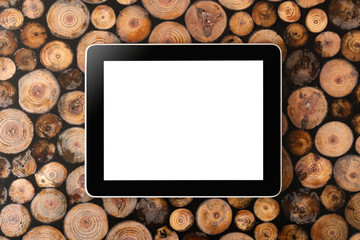 Digital tablet pc and mobile phone on wood background.Felled wood. Wood texture