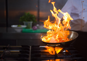 Chef doing flambe on food