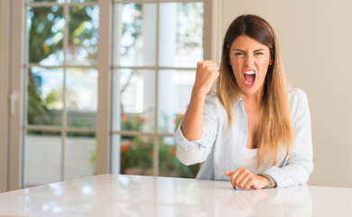 Young beautiful woman at home irritated and angry expressing negative emotion, annoyed with someone