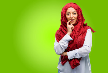 Young arab woman wearing hijab confident and happy with a big natural smile laughing
