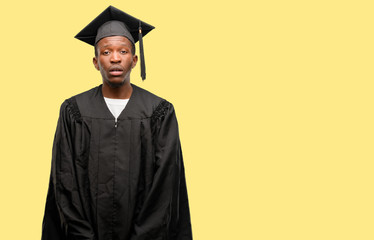 Young african graduate student black man with sleepy expression, being overworked and tired