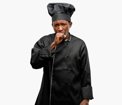 Young black cook wearing chef hat sick and coughing, suffering asthma or bronchitis, medicine concept
