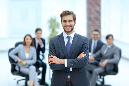 Successful businessman at the office leading a group