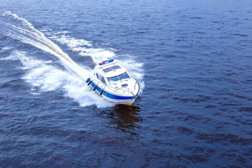 racing boat speed through the water, holiday concept
