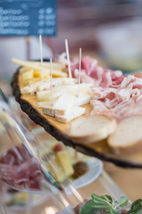 Delicious snack platter with cheese and ham on display on the buffet of a restaurant