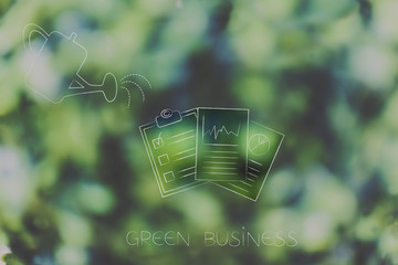 watering can and business documents going green, ecology concept
