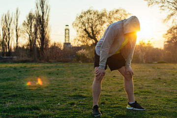 Runner taking breath after running in the park