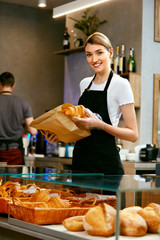 Bakery Shop. Happy Woman Selling Pastry