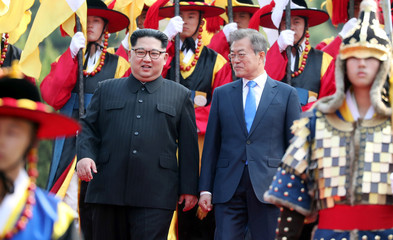 South Korean President Moon Jae-in and North Korean leader Kim Jong Un attend a welcoming ceremony in the truce village of Panmunjom