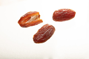 Delicious fresh organic dates on white background.