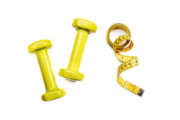 Sport dumbbells with tape measure on white background