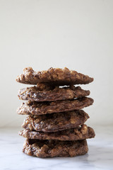 Close-up of cookies stacked on isolated white background