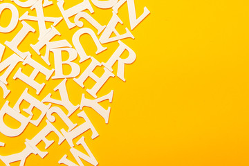 English font. Letters on a yellow background. White font.