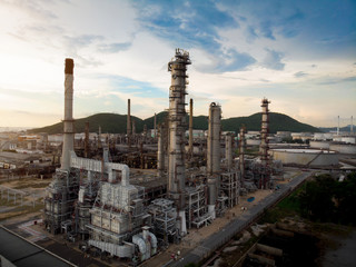 Aerial view of steel pipe oil refinery plant, power plant at sunset sky for industry concept.
