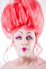 Man in drag with pink wig and lipstick Fluid Self