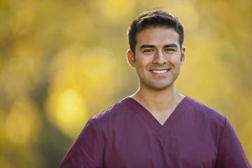 Portrait of a smiling male nurse.