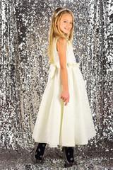 Pretty little girl in a white dress, fashion concept
