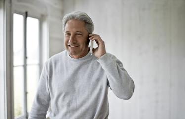 Builder speaking on cell phone.