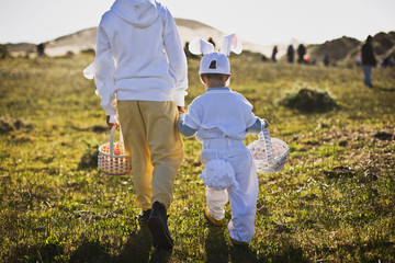 Two brothers in Easter costumes on an Easter egg hunt