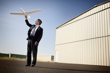 A man playing with a model airplane
