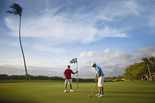 Couple playing golf together.