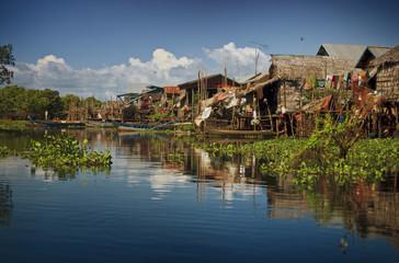 Stilt houses on river.