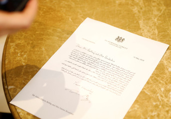News photographer takes a picture of a letter of apology from Britain's Prime Minister May to Libyan politician Belhadj and his wife, in Istanbul