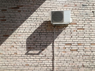 air conditioner on a brick wall