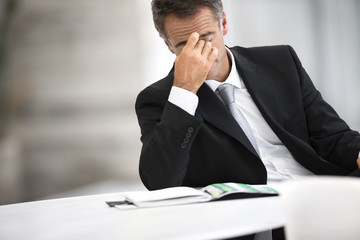 Businessman with a headache.