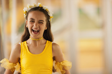 Portrait of laughing tween girl wearing ballet costume.