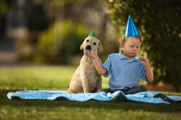 Boy having a picnic with his puppy.