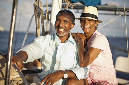 Mature couple enjoying the sun and view from boat deck.